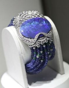 Cartier bracelet with black opal, diamonds, sapphire beads on white gold.