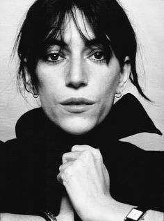 Stunning photo of Patti Smith. Patti Smith has not really ever taken time or cared too much about makeup (my guess) but she looks so pretty here.