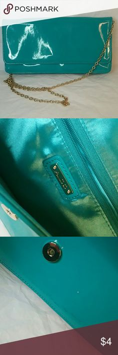 Aldo clutch with shoulder chain Aqua patent leather clutch with gold chain shoulder strap. In excellent shape refer to photos for condition Aldo Bags Clutches & Wristlets