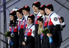 SOCHI, RUSSIA - FEBRUARY 10: (L-R) Silver medalists Kaetlyn Osmond, Patrick Chan, Kevin Reynolds, Meagan Duhamel, Eric Radford, Kirsten Moore-Towers, Dylan Moscovitch, Tessa Virtue and Scott Moir of Canada celebrate during the medal ceremony for the Team Figure Skating Overall on day 3 of the Sochi 2014 Winter Olympics at Medals Plaza in the Olympic Park on February 10, 2014, in Sochi, Russia. (Photo by Matthew Stockman/Getty Images)