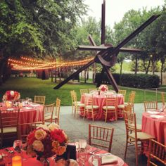 Pink table settings at outdoor wedding at the Nasher Sculpture Center in Dallas, Texas
