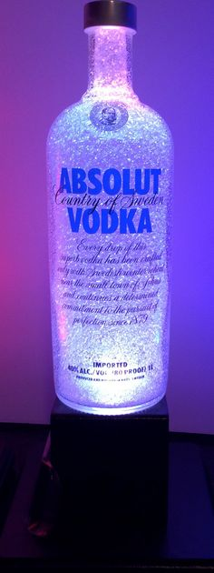 """Glass Vodka Bottle Lamp - Color changing LED up-cycled recycled Lamp. It's a """"wide angle LED"""" in it. WOuld love to find out where to get one. Alcohol Bottle Crafts, Alcohol Bottles, Liquor Bottles, Wine Bottle Crafts, Glass Bottles, Vodka Bottle, Alcohol Bottle Decorations, Liquor Bottle Lights, Diy Bottle Lamp"""
