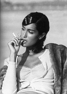 yasmeen ghauri circa 1990's  This model is beautiful, but the cigarette could have been left out.