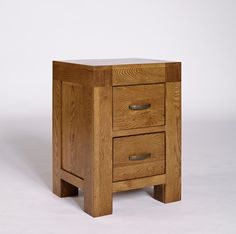 Santana Rustic Oak Bedside Cabinet - The Santana Rustic Oak collection is made using North American partially reclaimed oak, with a rich patina finish to accentuate the grains of the timber. Substantial in size and build, this range has been crafted both to last and to impress. Pieces in the range include attractive pewter-coloured metal handles. The Santana Rustic Oak collection is crafted from solid oak and carefully-selected oak veneers.