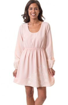 Round neck long peasant sleeve floral lace design dress featuring elastic waist, elastic cuffs, and back keyhole with button close. Classy slightly retro-inspired dress to have for garden parties. $11.95
