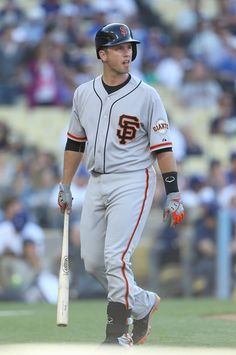Buster Posey #28 of the San Francisco Giants looks on after striking out in the first inning against Zack Greinke #21 of the Los Angeles Dod...