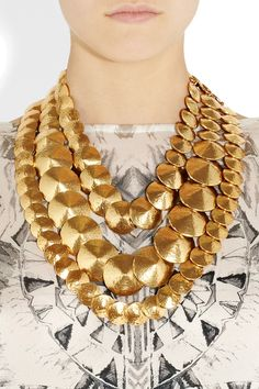 ha HA! I volunteer at Housing Works and I just bought a necklace like the top strand here for $12 with my volunteer discount! (note that the necklaces in the picture are Oscar de la Renta, soooo....I guess I'm saying that I feel pretty cool right about now.)