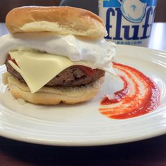 Fluffburger - A specialty burger from Schuylkill County PA. Ultra buttered rolls, burger, hot sauce, cheese, minced onion, & Marshmallow  Fluff. Inspired by Tony's Lunch.