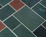 Random multi-color slate flooring -- an authentic mid-century choice - foyer floor with darker grout