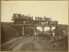 [Locomotive on bridge over streetcar] c 1904. Probably at the outskirts of Seoul, where the new tramcar was installed in 1899. Willard D. Straight/Early U.S.-Korea Diplomatic Relations, Cornell Univ Library