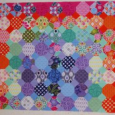 Threadbias: Colors of Spain Quilt by Caribousmom.Once again she makes an inspiring quilt. One day.....