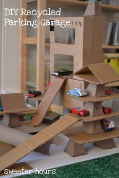 Sweeter Hours: Sweet Makes: DIY Recycled Parking Garage for a Sweet 3 year old to make with cardboard boxes from our move Cardboard City, Cardboard Crafts, Cardboard Playhouse, Cardboard Furniture, Cardboard Cartons, Creative Activities, Activities For Kids, Diy For Kids, Crafts For Kids