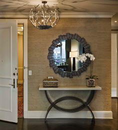NOT MY DECOR TASTE, BUT LOOK @ THE WAY THE CIRCULAR MIRROR PLAYS AGAINST THE HALF-CIRCLE TABLE BASE -- GENIUS FOR IMPACT.--SLA