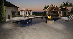 Simply stunning! Upgrade your outdoor space with Tuscany Beige Tumbled Pavers and Pool Copings!