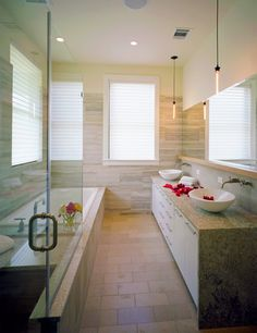 glass shower idea incorporated into tub layout makes room look larger!