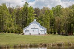 The prettiest white barn venue set on acres of lush grasslands in Virginia. Water views included.