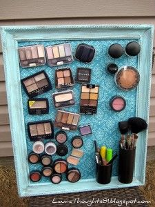 Paint an old cookie sheet (or cover it with fabric), glue a frame to it, then put adhesive magnets to the back of makeup and attach to dried cookie sheet.  Could use this for lots of other things too.