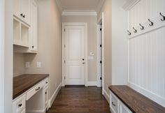 LOVE this white and wood mudroom/entryway space! The beadboard on the walls with the hooks, the bench with the drawers beneath and the built in desk area make this a perfect space to walk into when you come home! This gorgeous home in Greenville, SC is for sale! See and read more here - http://www.goodwinfoust.com/homesforsale/