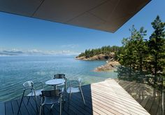 tula house by patkau architects hangs over cliff edge in british columbia, canada