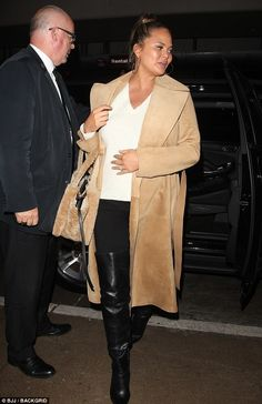 Chrissy Teigen flaunts her baby bump in a camel coat   Daily Mail Online