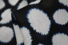 Snow Blossom - Printed 100% Linen available at Tessuti Fabrics < looks like a capped shibori pattern