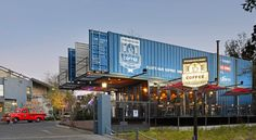 Cantilevered shipping container coffee shop pops up in Johannesburg   Inhabitat - Sustainable Design Innovation, Eco Architecture, Green Building