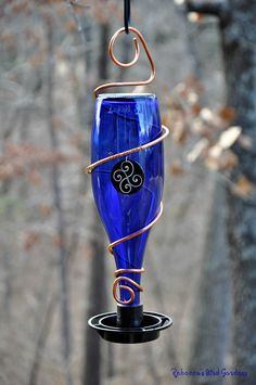 Glass Bottle BirdFeeder by RebeccasBirdGardens on Etsy,