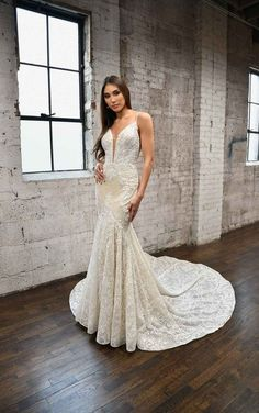 Head-turning glamour meets timeless bridal. The plunging V-neckline bodice is covered in floral lace, encrusted with intricate beading. Glittering beaded straps on this wedding dress provide support, and in the back, they split into three shimmering strands. The fit-and-flare silhouette hugs the body's natural curves beautifully, with the skirt flaring out. The skirt and train are adorned with glittering lace. Timeless bridal beauty to an ultra-modern, sexy look.  Martina Liana   Style: 1348 Bridal Elegance, Fit And Flare Wedding Dress, Bridal Beauty, Designer Wedding Dresses, Bridal Gowns, Marie, Glamour, Wedding Happy, Wedding Wishes