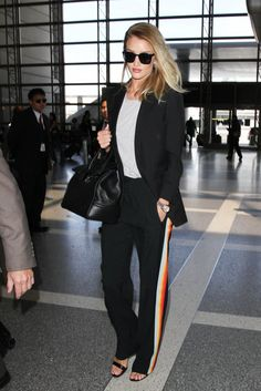 Choose a pair of track pants with a colorful stripe, and cover them with your streamlined blazer. The look ...