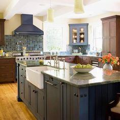 Colorful kitchen backsplash and farmhouse sink in black island. There's so much we love here!