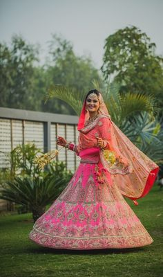 twirling bride shot, twirling lehenga shot, barbie pink lehenga, gold embroidery, Sikh Bride . sikh bride