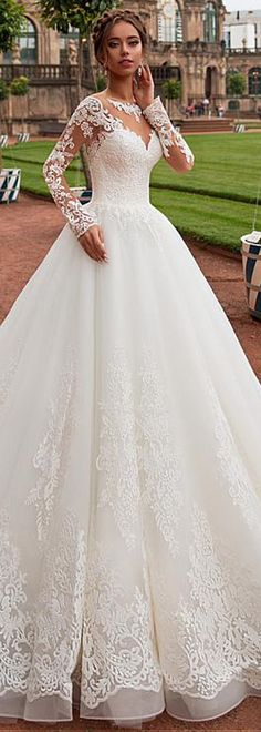 Modest Tulle Jewel Neckline A-line Wedding Dress With Lace Appliques & Beadings