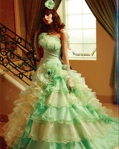 This beautiful lime green and gold colored wedding dress is made with Gorgeous Bridal Organza.