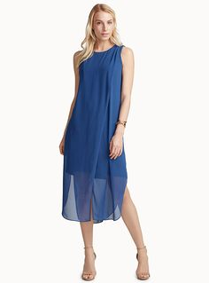 Exclusively from Contemporaine - An elegant, modern dress with a minimalist straight silhouette, long side slits and crossover design that delicately drapes at the shoulder - Fluid chiffon with knee-length stretch jersey lining and a playfully feminine sheer effect at the hem The model is wearing size 4 Length: 124cm, from the top of the shoulder