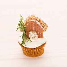 How adorable + festive is this Gingerbread Cupcake topped with a gingerbread house for the holidays?!