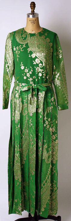 Christian Dior Haute Couture evening gown ensemble from fall/winter 1973-1974 by designer Marc Bohan. Long sleeve maxi dress with bow at the waist and come with a matching shawl made from green silk with patterned metalic thread and feather. House of Dior.