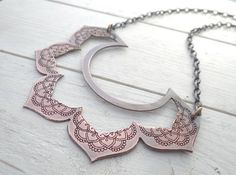 Bold statement necklace that doesnt overwhelm. I cut his lotus flower from copper and etched an exotic design on the petals. It dangles from a