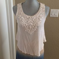 """Forever 21 Short Ivory Tank: Medium Lovely little Ivory colored tank by Forever21 with embroidery at front to shoulders. Very lightweight and comfy. Laid flat: Bust 19""""; Waist 21""""; Length 20"""". Forever 21 Tops Tank Tops"""