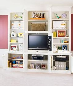 The inside of these entertainment center doors are painted with chalkboard paint to keep kids entertained!