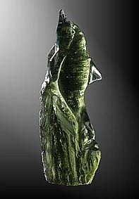 Moldavite, dolphin on rock