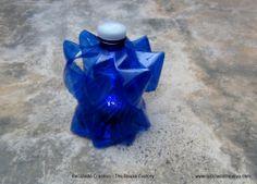 Lámpara realizada con una garrafa y una botella de plástico