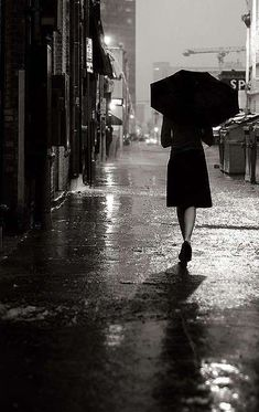 Black and white Photography woman walking down street with umbrella on rainy night alleyway Black N White, Black White Photos, Black And White Photography, I Love Rain, No Rain, Walking In The Rain, Singing In The Rain, Rainy Night, Rainy Days