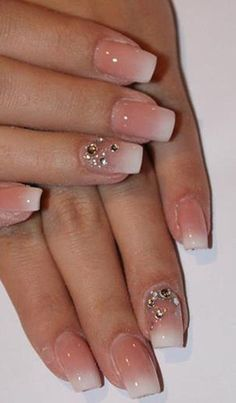 Love this simple nail design with rhinestones for a touch of elegance .