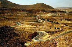 Tunisia's rock desert near Matmata with the grey road zigzagging through the yellow/brown scenery.Buy prints or cards at eva-kato.artistwebsites.com
