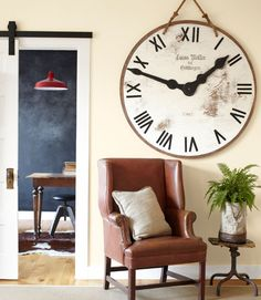 The owners of this Washington estate assembled a nonfunctioning clock with $23 of rope and plywood, plus leftover paint and hands cut from scrapwood. A burlap T.J. Maxx pillow, only $10, contrasts with a leather armchair scored on Craigslist.   - HouseBeautiful.com