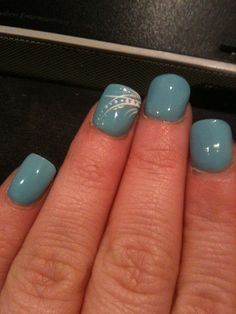 Nail Designs    Blue nails with pretty design on ring finger!