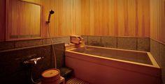 Wood-paneled onsen interior.