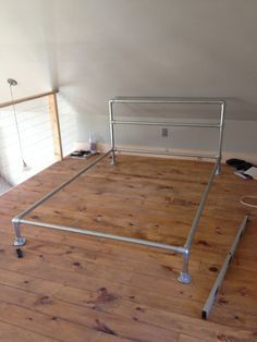 How to Build a Pipe Bed Frame (don't want head board & I want it to sit higher off floor for storage under bed)(I can put the pipe frame together no problem, but the wooden platform?)