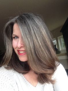 """""""Growing out gray hair. 14 months of growth. February 2015."""" This is my shade of grey - it's gorgeous on her. I'm 8 months in now and thinking of cutting short to be closer to done."""