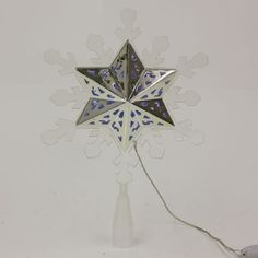 The silver juxtaposed with the snowflake exterior is what makes this tree topper special! Christmas Tree Toppers, Christmas Decorations, Unique Tree Toppers, Tree Tops, Snowflakes, Decor Ideas, Exterior, Led, Skirts
